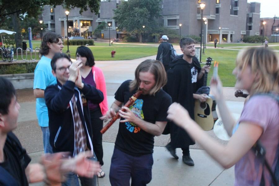 +The+group+dances+around+with+sage+sticks.