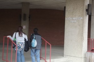 Students Entering LWH looking at the nameplate - Photo by Juan Gonzalez