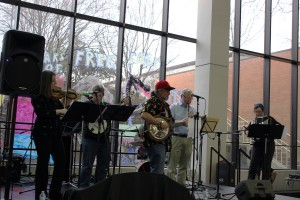 ChickenFat performing on stage in the cafeteria