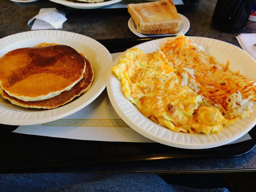 Pancakes with Toast, a Chicken and Cheese Omelet and Hash Browns
