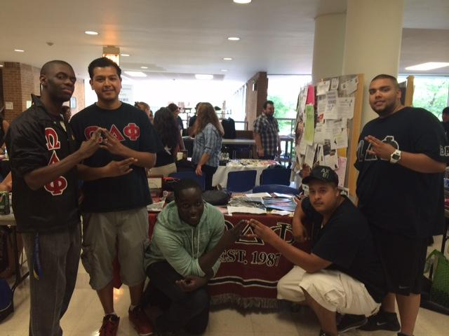 embers of Omega Delta Phi salute: (left to right) Jeraun Pearson, Victor H. Gonzales, Seth Amofa, Jairo Arellanes and Giovanni Baez.