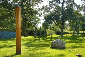 "In six different languages, the peace pole reads ""May peace prevail on earth."" On the right is a 1.8 billion year old crystal."