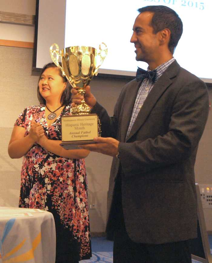 Dr. Frank Gaytan accepts the Annual Futbol Champions award on behalf of Team ENLACE.