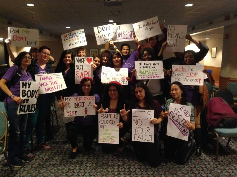 "Members of Feminist Collective and event attendees gathered at ""Take Back The Night"" event at NEIU."