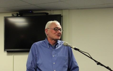Ken Davis, a founder of WZRD and The Independent's precursor, the print, presents to students in the Student Lounge