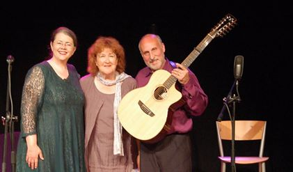 Kathy Cowan [left] and Joseph Sobel [right] stand with their producer Liz Weir [center] at the Little Theatre in Cushendell.