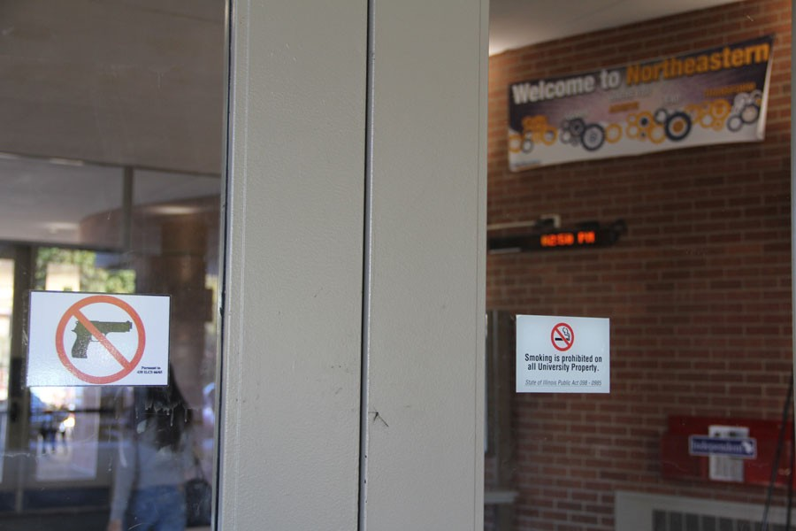 A+%22no+guns+allowed%22+sticker%2C+one+of+the+many+on+campus%2C+is+displayed+on+the+doors+of+Lech+Walesa+Hall.+