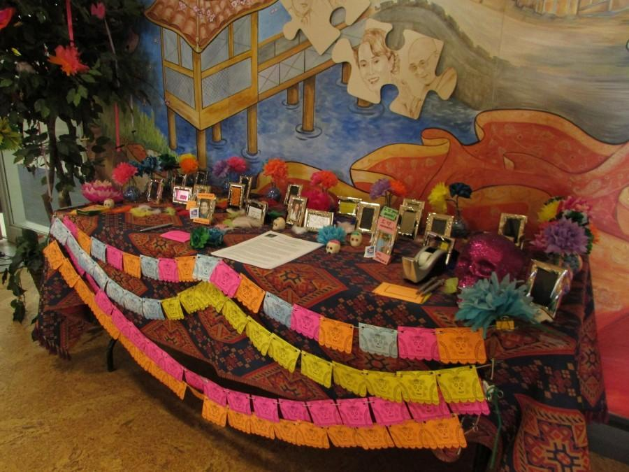 Members of the NEIU community honor their departed loved ones at the Dia De Los Muertos Altar in the Angelina Pedroso Center