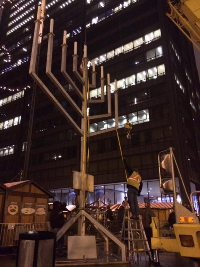 Crews+finish+putting+up+the+Grand+Menorah+for+this+year%27s+lighting.