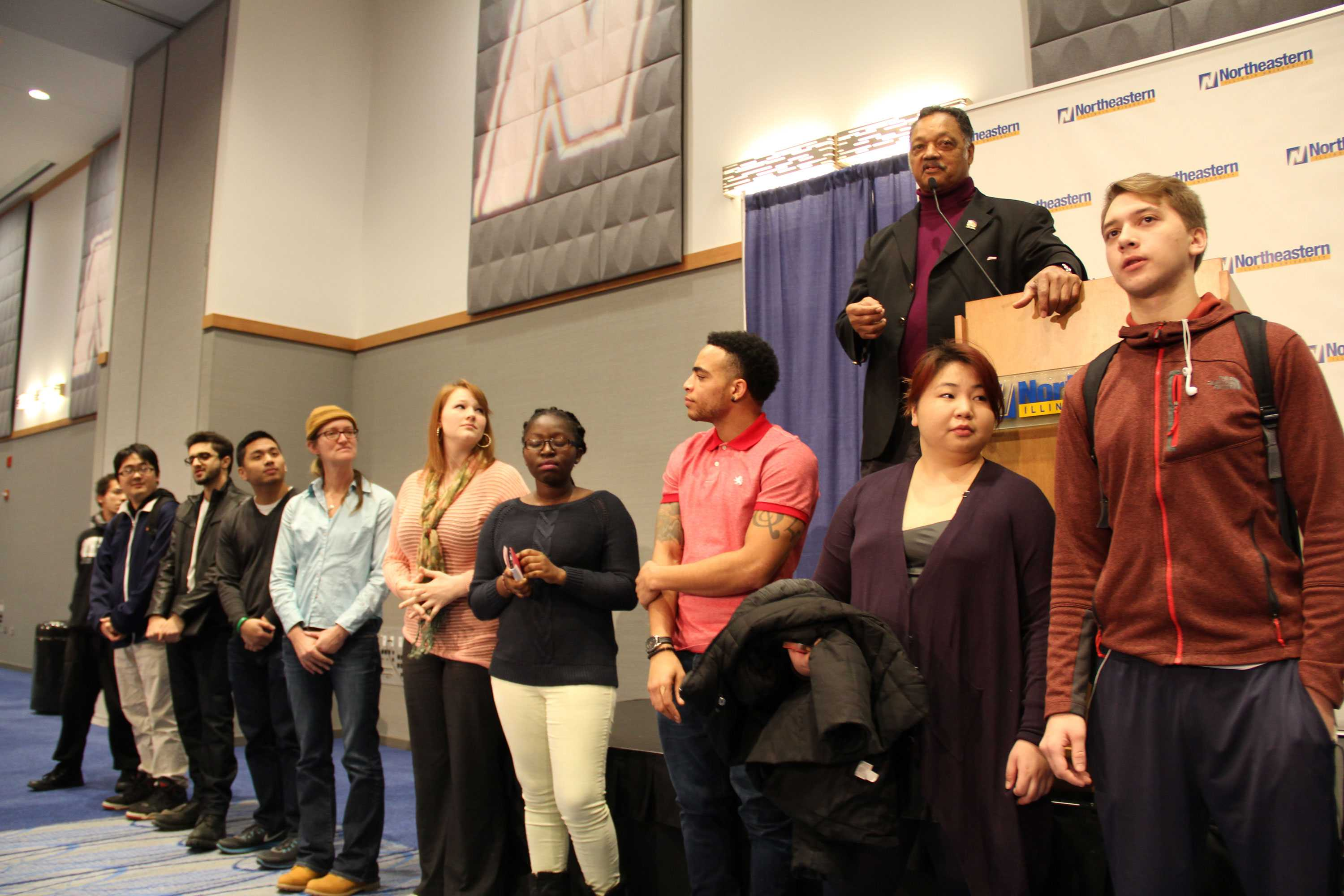 Jesse Jackson, Sr. encouraged unregistered voters to come to the stage and become registered. Ten students answered the call during his speech at Alumni Hall.