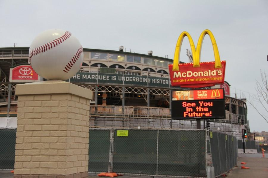 Familiar landmarks are going down, as Wrigley continues to build up.