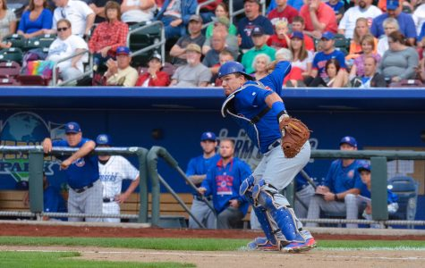 Kyle Schwarber making a throw. Photo by Minda Haas. @minda33