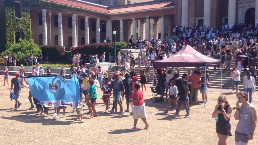 Students+gather+in+protest+of+tuition+hikes+at+the+University+of+Cape+Town.%0A