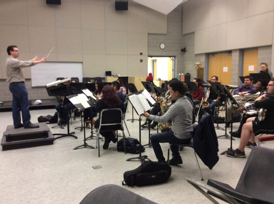 Dr.+Travis+Heath+conducts+a+band+rehearsal+with+committed+students.%0A