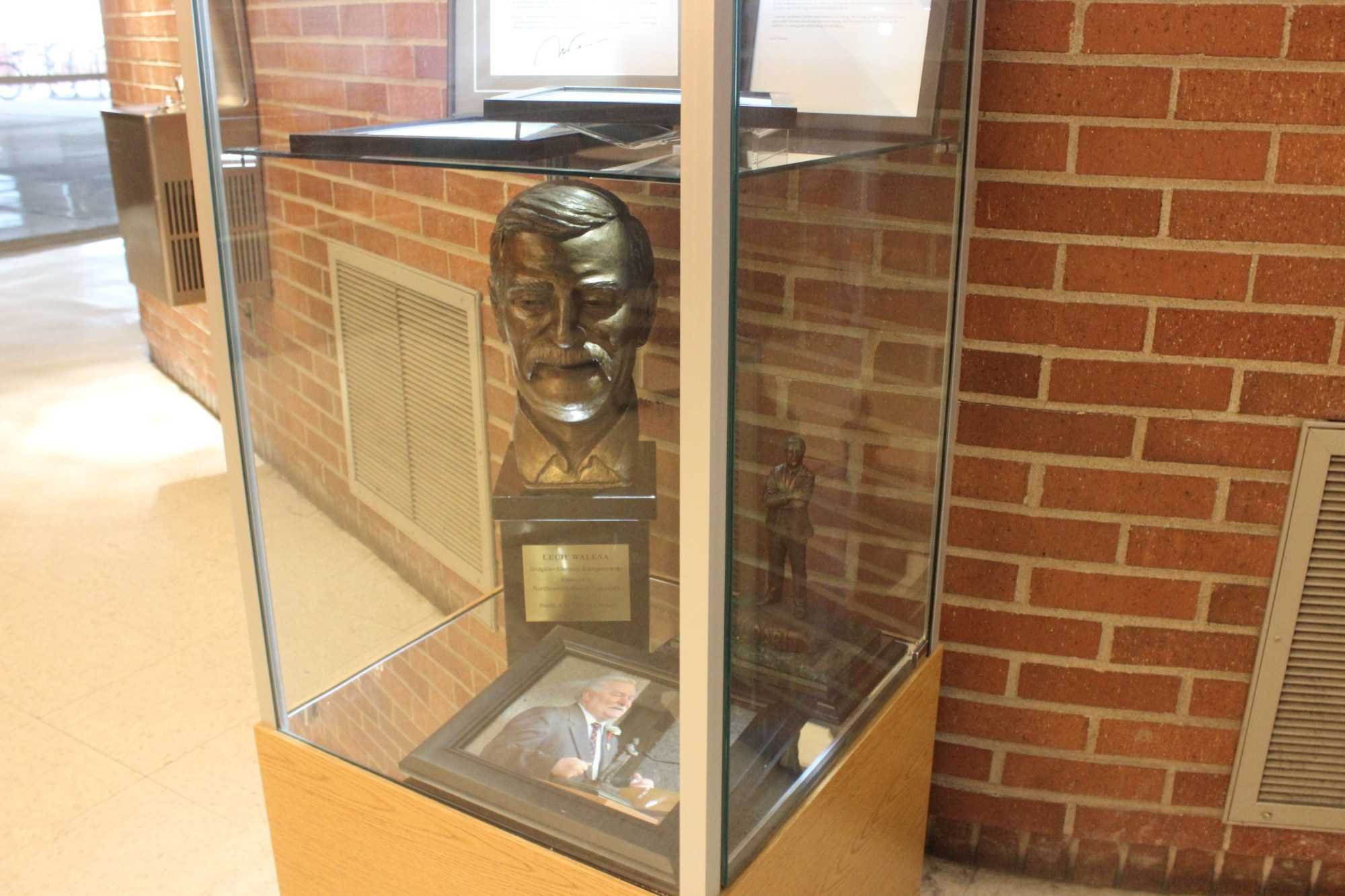 A display shows a bronze bust and Walesa's written letters to NEIU.