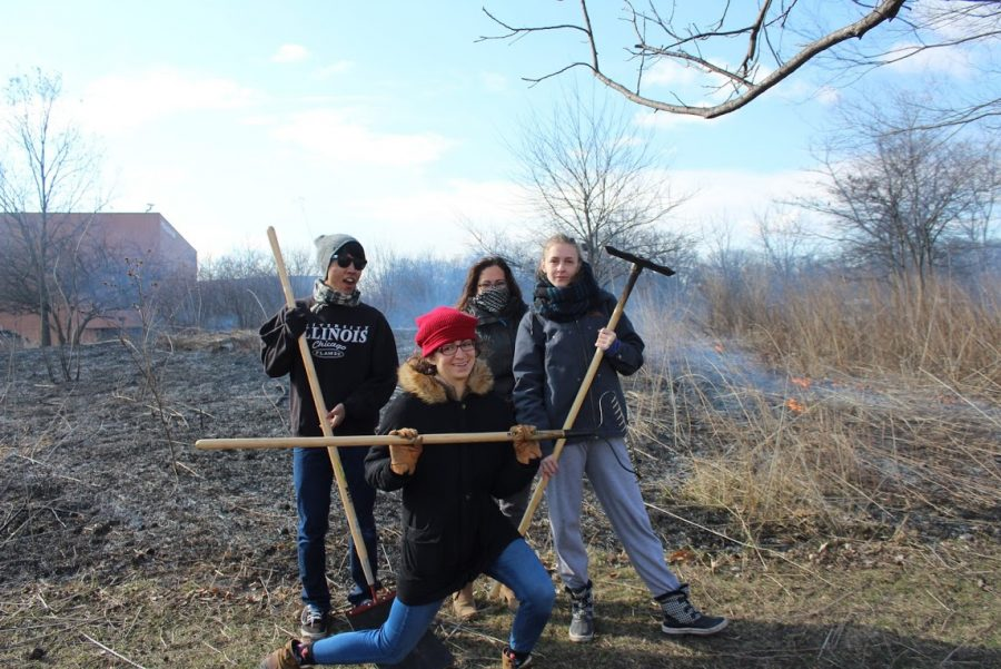 Back left to right: Henry Thach, Frances Beckman, Christina Tilley. Front: Gabriella Claborn  Students from Dr. Alex Peimer's class attend the prairie burn as extra credit and for fun.