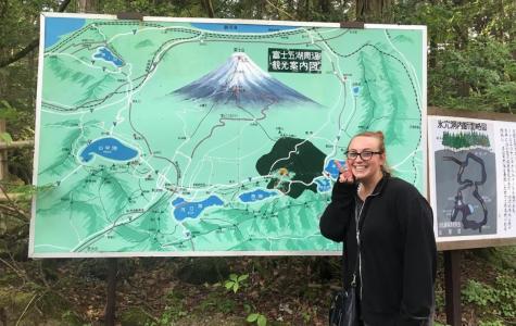 Photo of Stephanie hiking Mount Fuji in Japan.