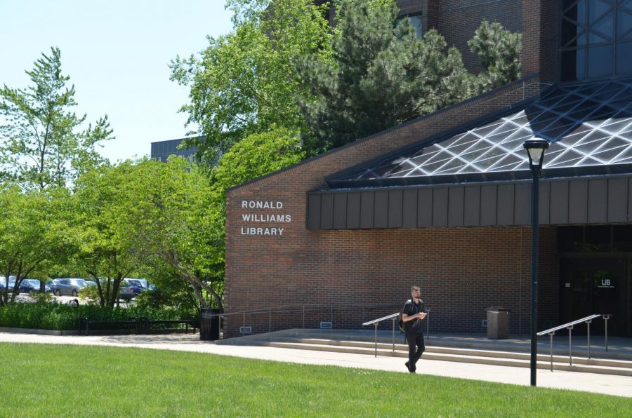 Student walking across Ronald Williams Library.