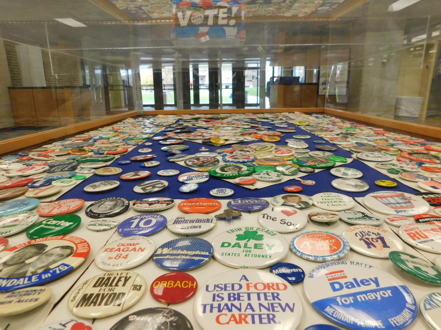 Archival political pins in the Ronald Williams Library. Display set up by Digital Scholarship Librarian and Assistant Professor Alyssa Vincent, Social Sciences Librarian and Assistant Professor Ed Remus and Administrative Assistant Bonnie Pfeiffelman.