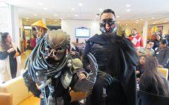 Xiadany Ayala and Anthony Pacheco as Predator and Dark Jedi.