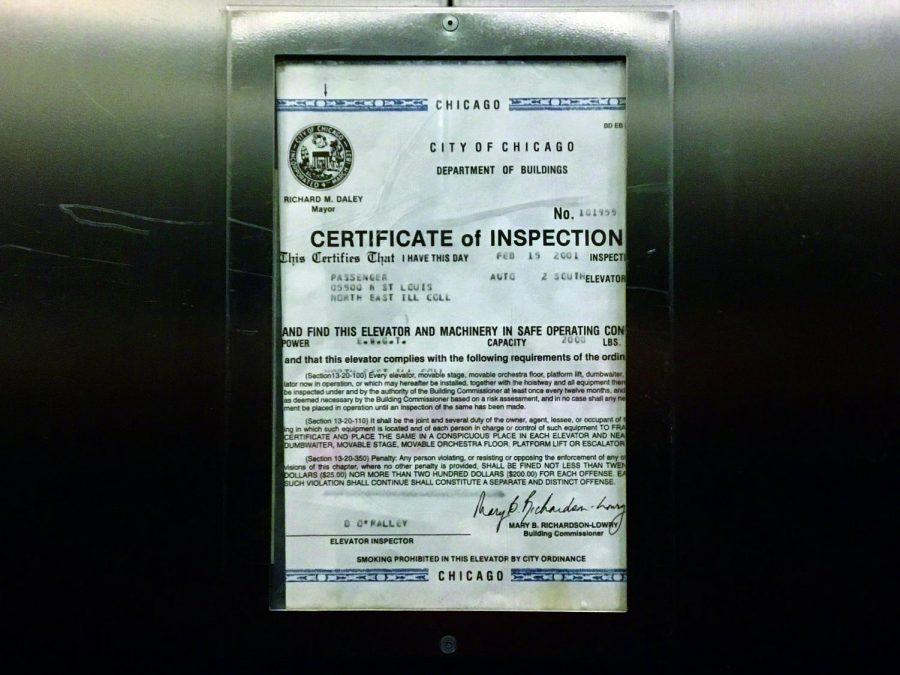 Photo+of+an+elevator+in+NEIU%27s+Sach%27s+building+with+a+certificated+dated+from+2001.+Photo+was+taken+in+early+Feb.+2019.