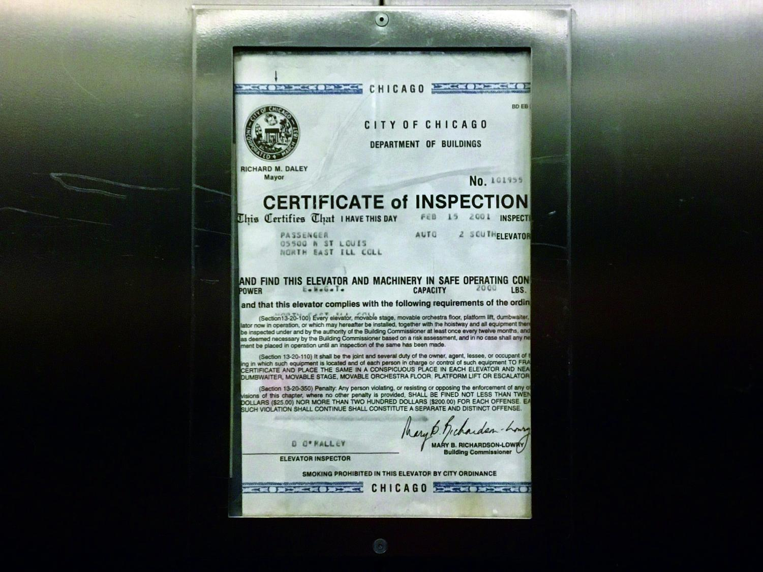 Photo of an elevator in NEIU's Sach's building with a certificated dated from 2001. Photo was taken in early Feb. 2019.
