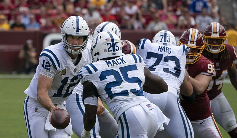 Andrew Luck hands the ball off to running back Marion Mack during the Colts' Sept. 16, 2018, contest against Washington