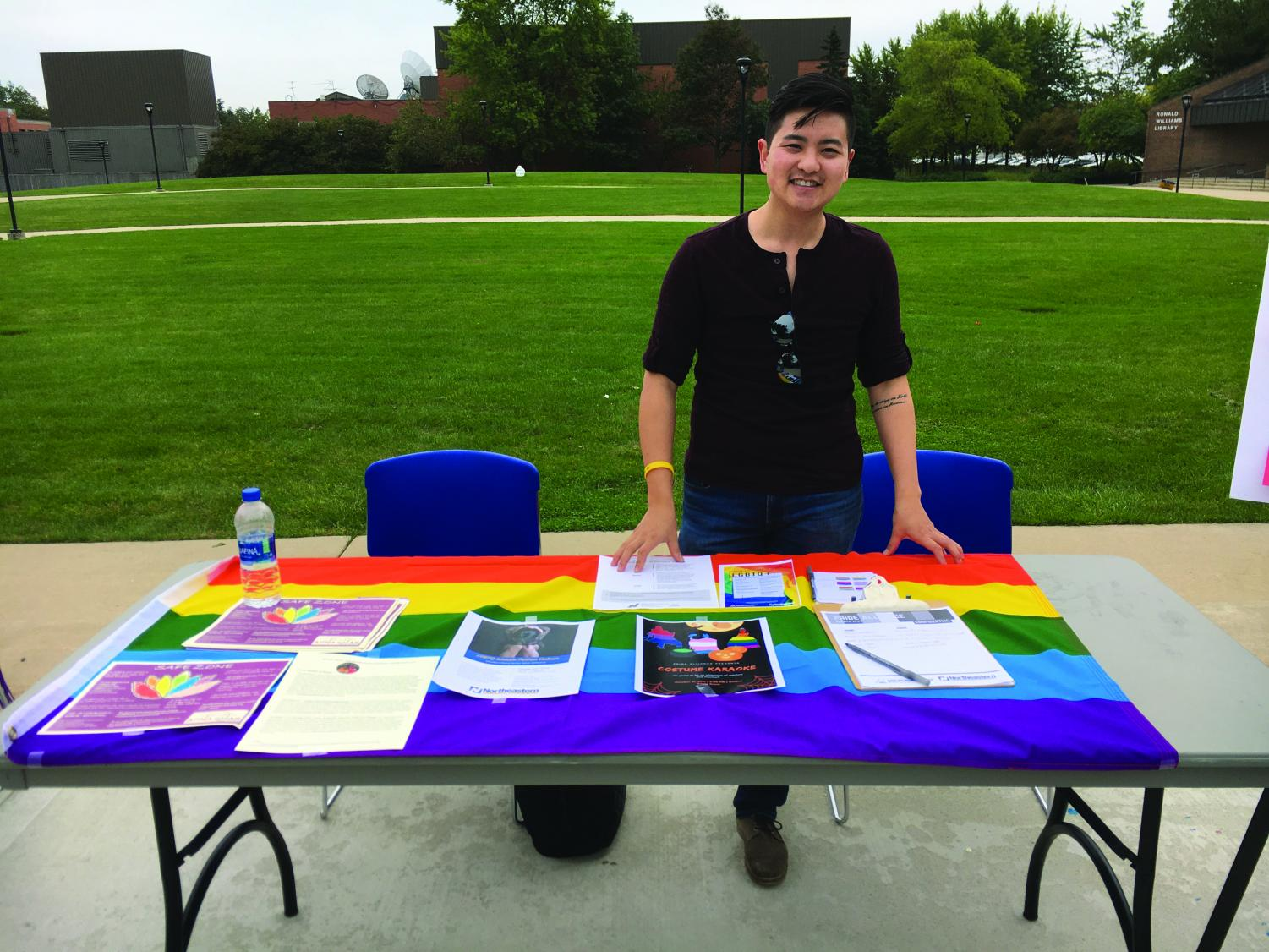 Francis Ahn welcomes students to the resource fair at the Pride Alliance table. | Photo by Rebecca Denham