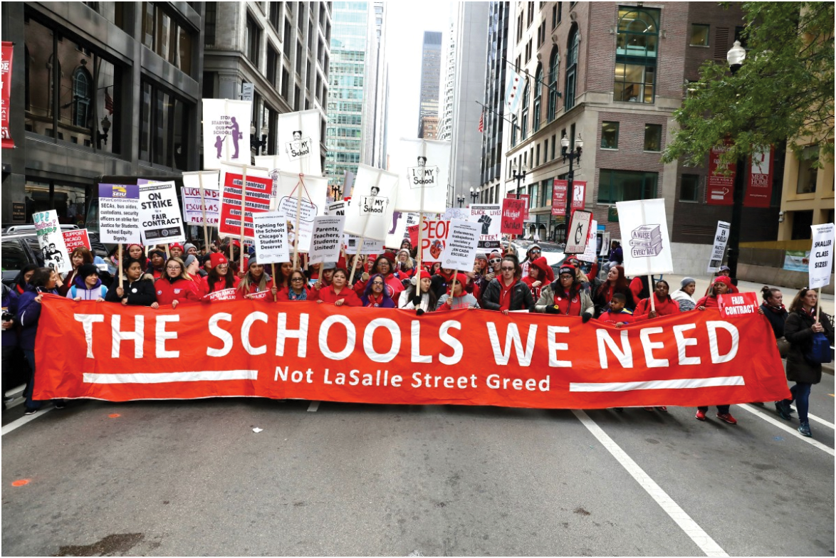Chicago teachers and their supporters march downtown. | Photo by: Manuel Martinez/WBEZ