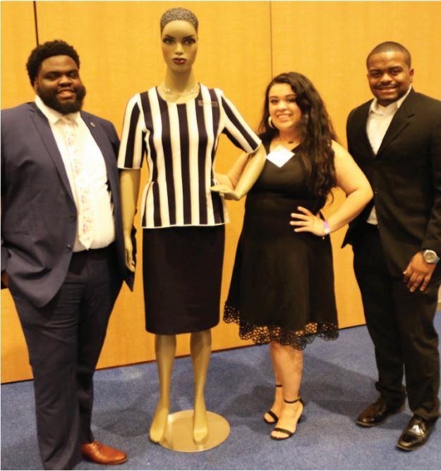 Eric Winslow, Issalma Franco and John Rayburn posing with Alisha, one of the Power Closet's famous mannequins around campus. | Photo by Frannie Mendoza