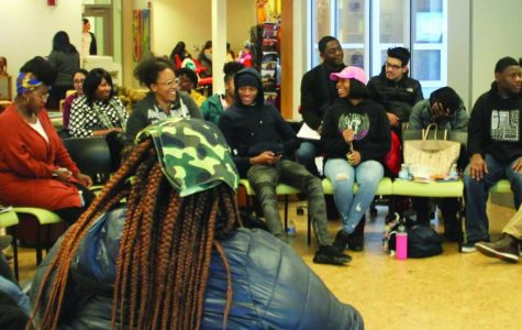 The audience share the experiences they have had with hairstyle discrimination and texturism. | Photo by Tim Le Cour