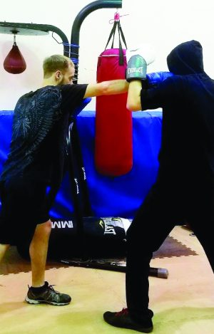 Phillip Noffz and Matthew Scanlan sparring at boxing club| Photo by Rachel Willard