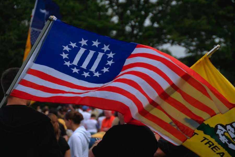 Flags associated with right-wing groups wave during