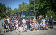 The Operations Management class line up with Engine Company #89 in front of the engine.